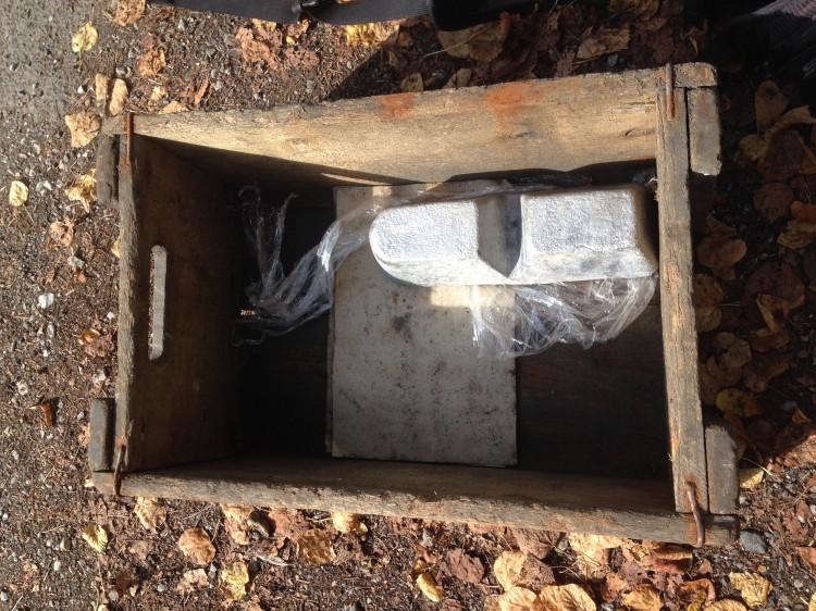 Aluminum block and wooden crate